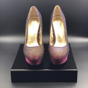 Iridescent pumps with golden overlay.